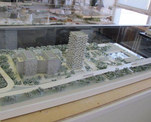 Monochromatický prezentačný model bytových a administratívnych objektov