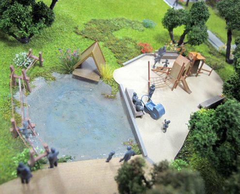 Farebný prezentačný model bytového komplexu umiestneného v svahovitom teréne